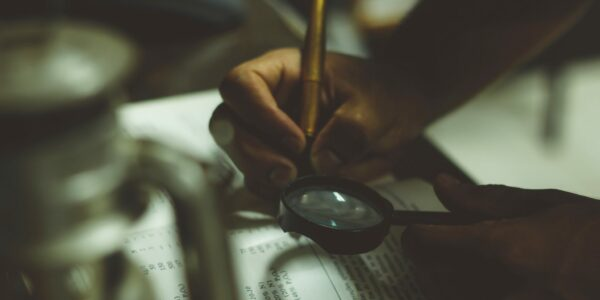 Searching through a book with a magnifying glass