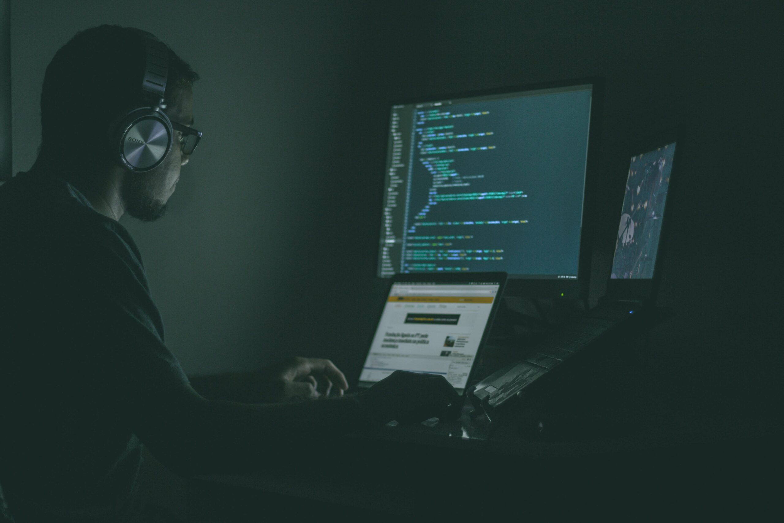 man on computer: cyber crime penalties and cyber crime sanctions