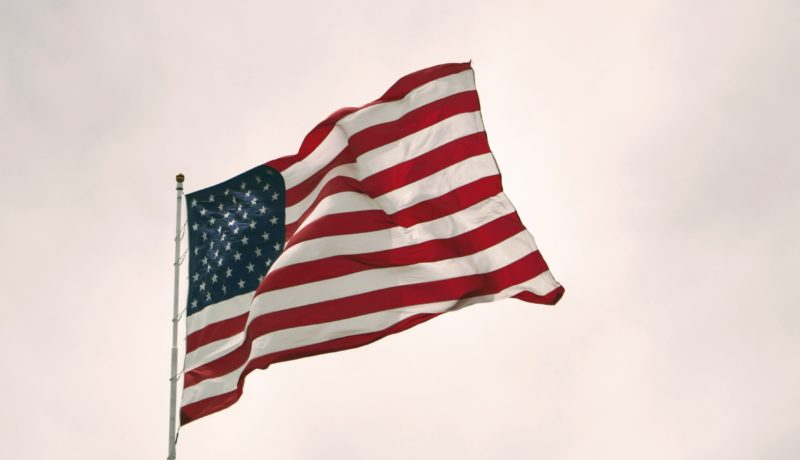American flag: primary and secondary sanctions