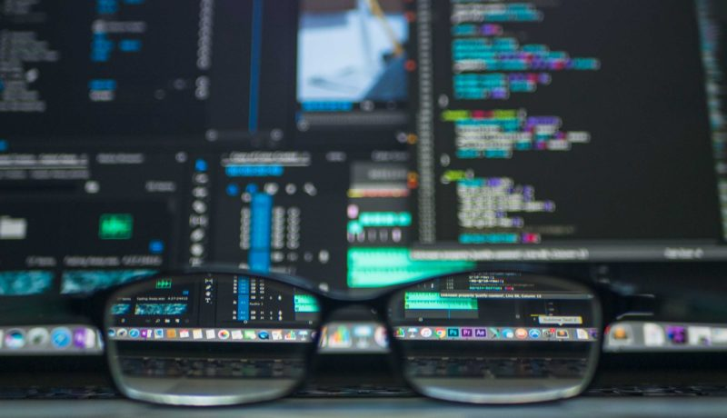 Screen with code: Why is RegTech Important to adopt